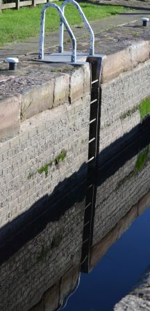 Deep lock ladder    reflected in the still water.