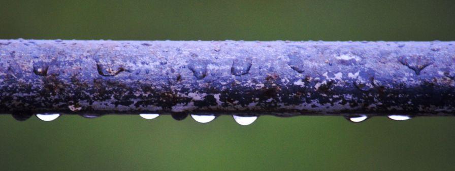 Raindrops on handrail