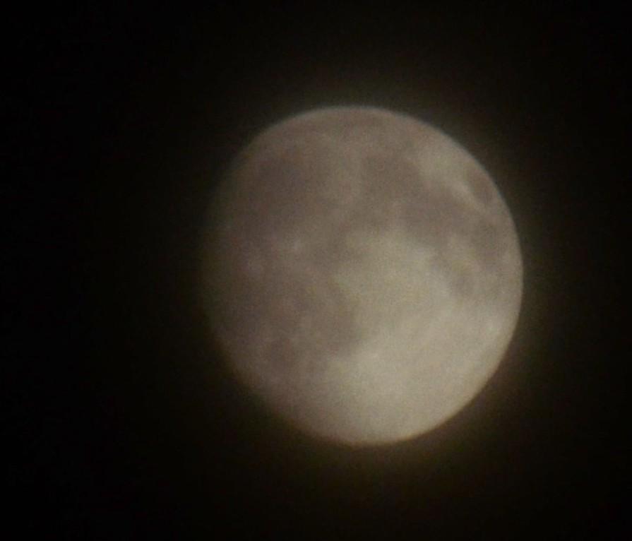 Moon hiding in cloud